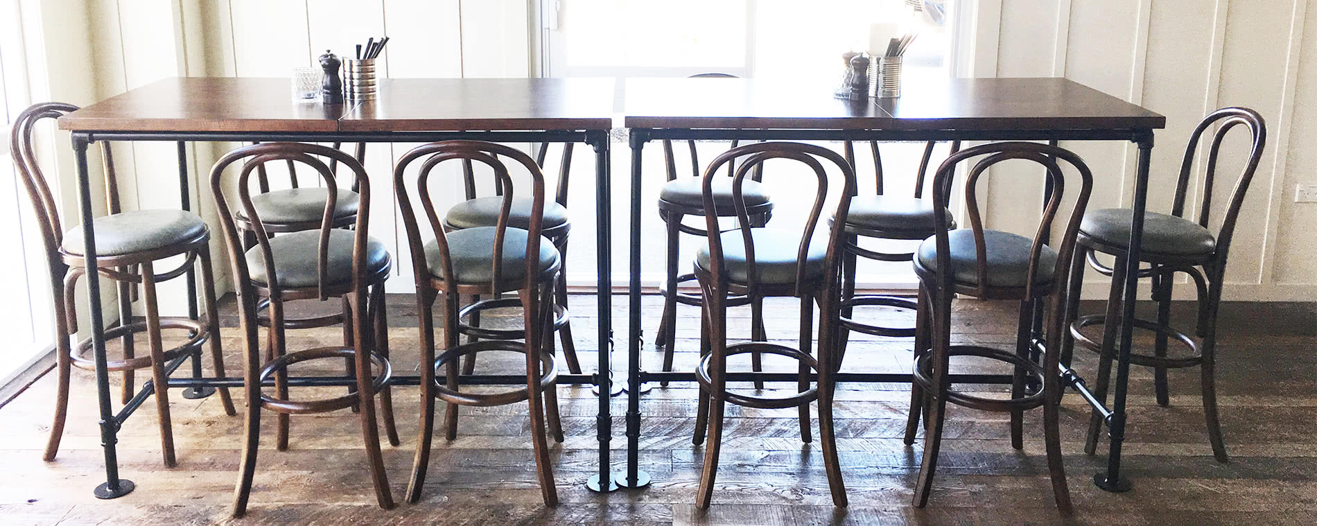 Furniture Provided for Riverhead Restaurant includes rustic tables and chairs